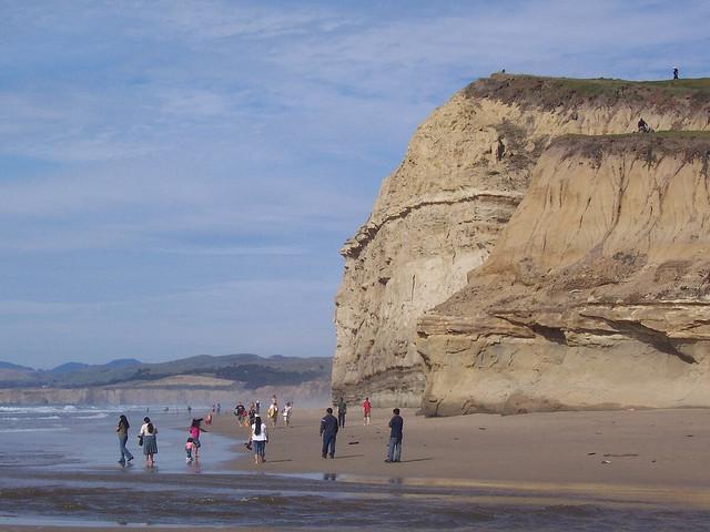 Women Walking On Beach During Sunrise Stock Image - Image
