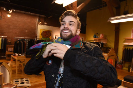 Myles Thatcher, a dancer for the San Francisco Ballet, tries on a colorful scarf at MAC in Hayes Valley.