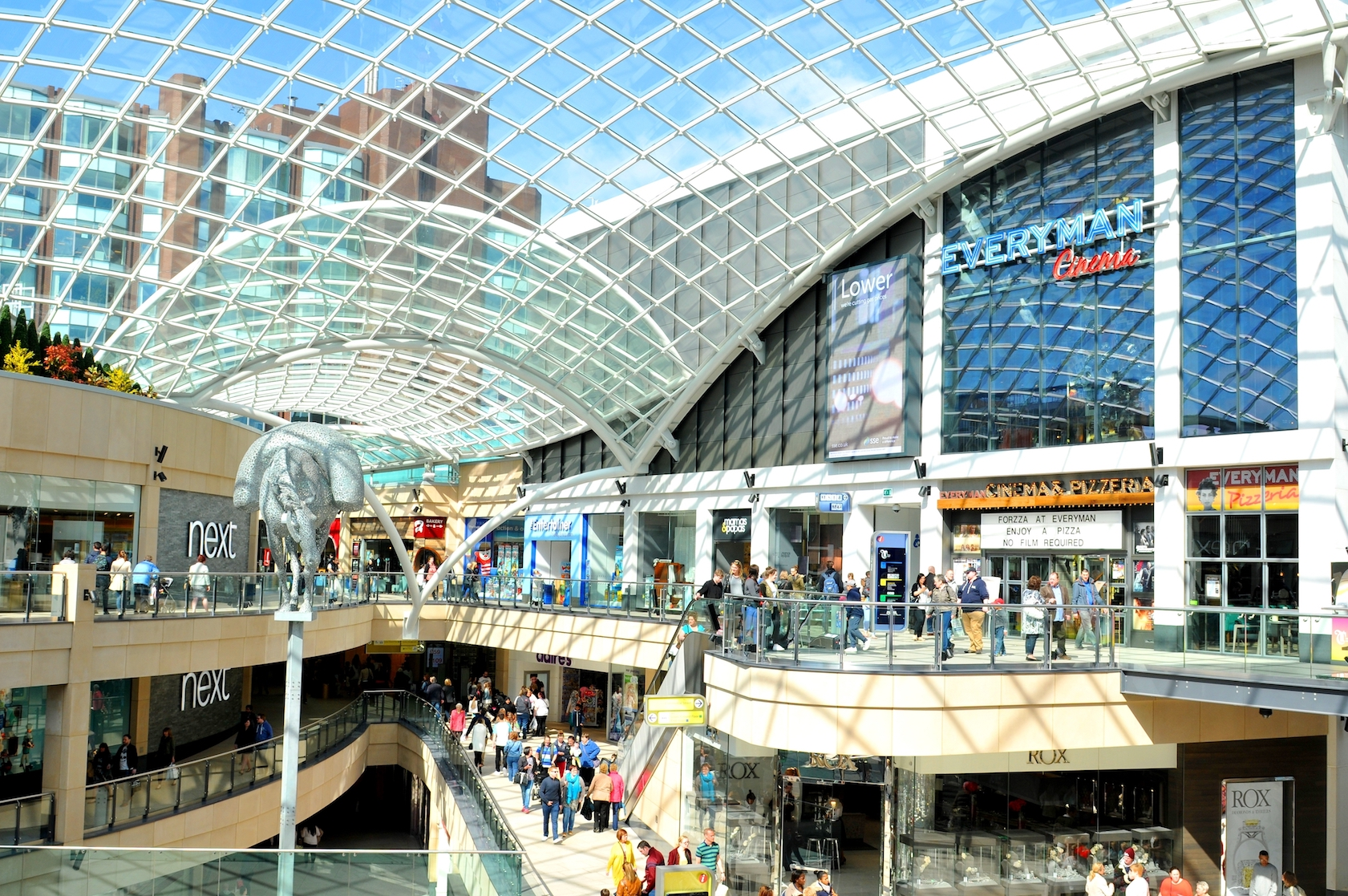 Trinity Leeds Mall in Leeds, England, filled with shoppers on a sunny day.