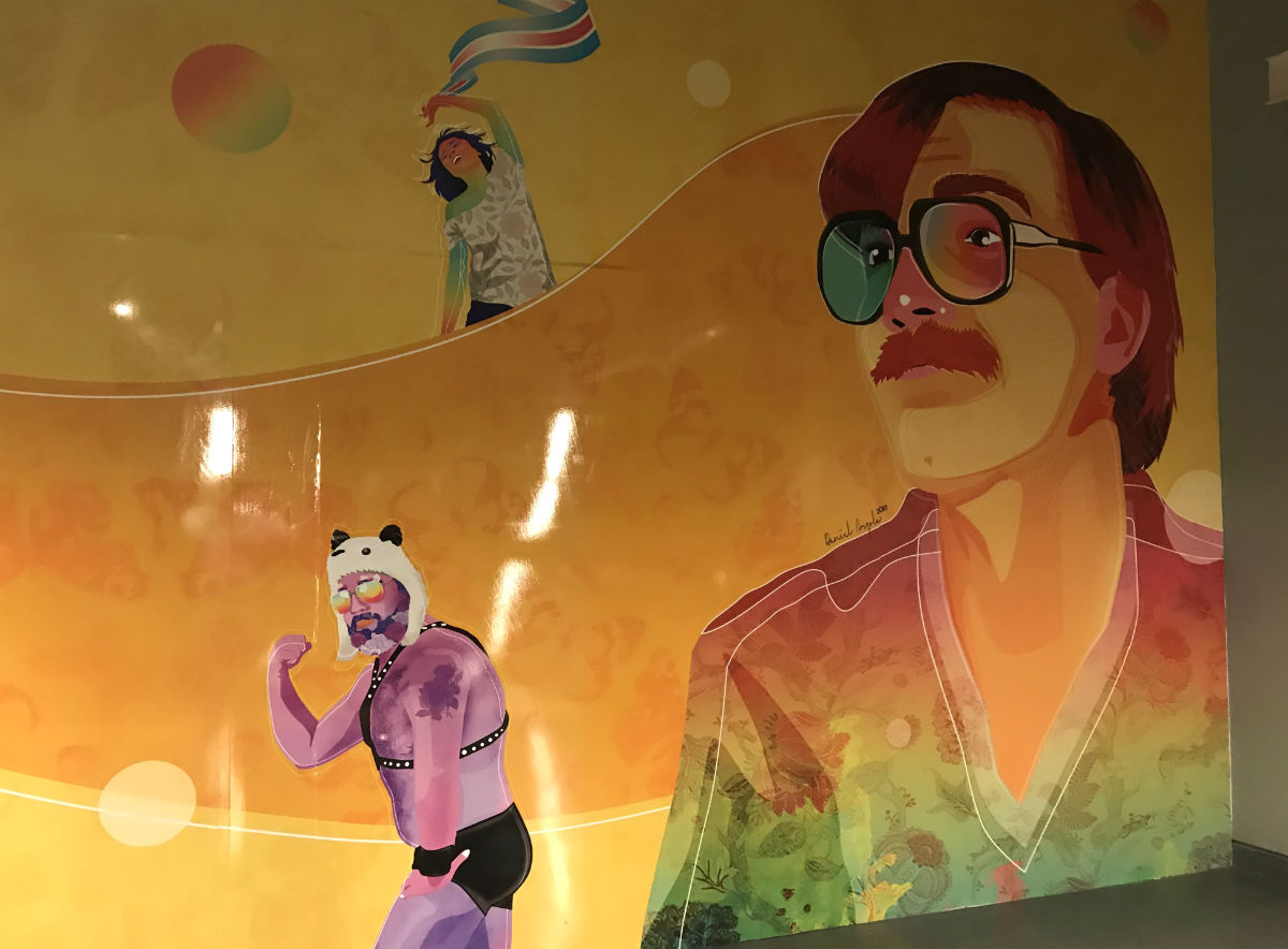 A mural featuring Carlos Jaúregui (right) in the Buenos Aires subway station