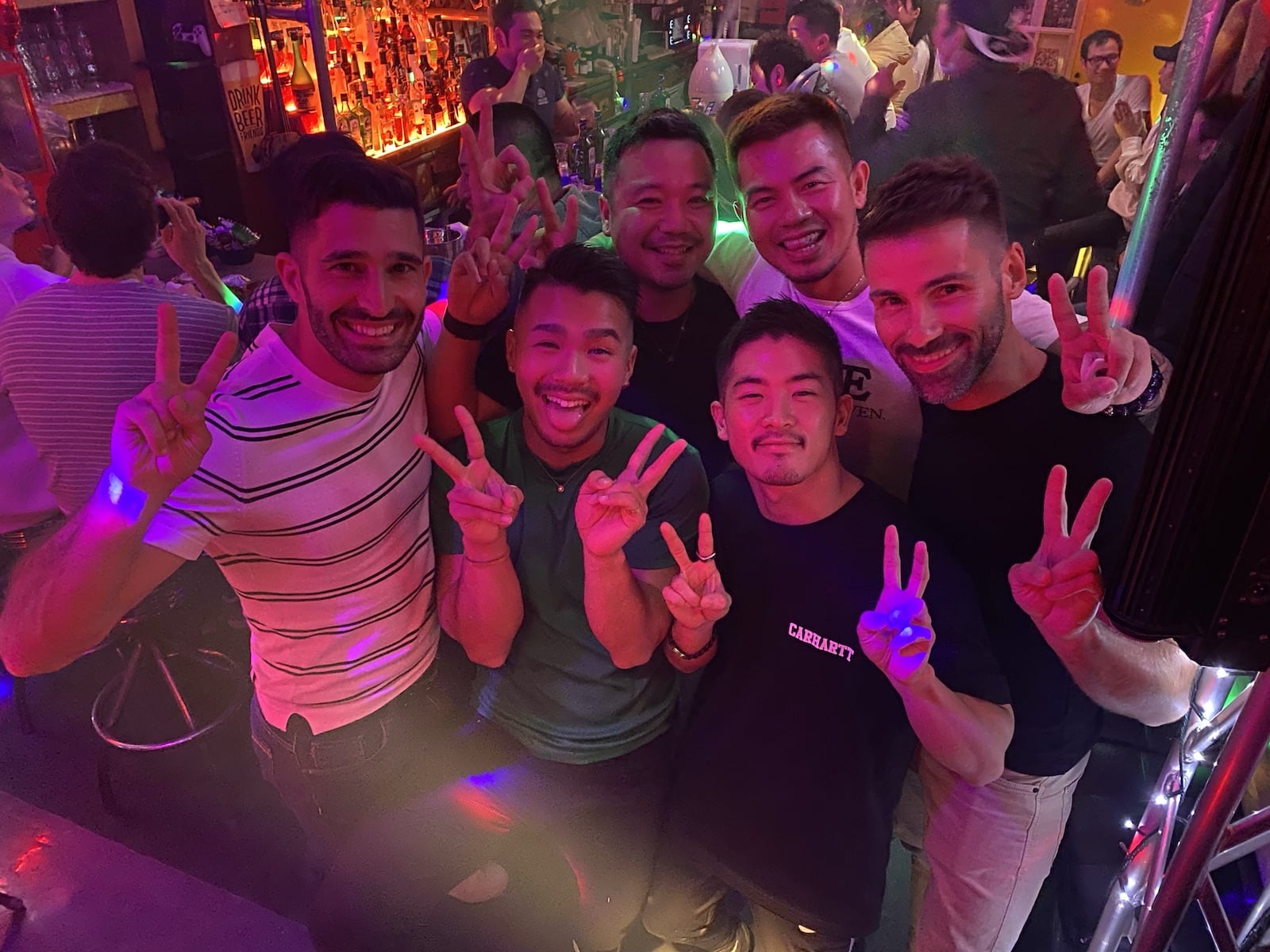 Nomadic Boys hanging out at a gay bar in Tokyo.