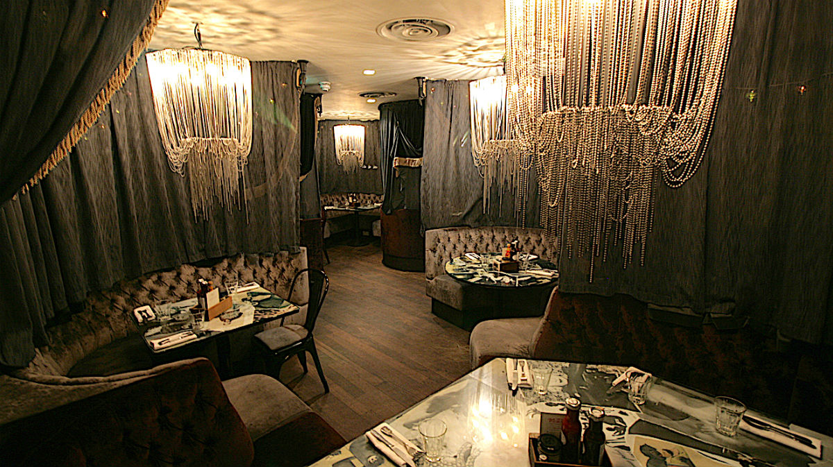 The plush booths at the back of Balans No 60, Old Compton Street, London