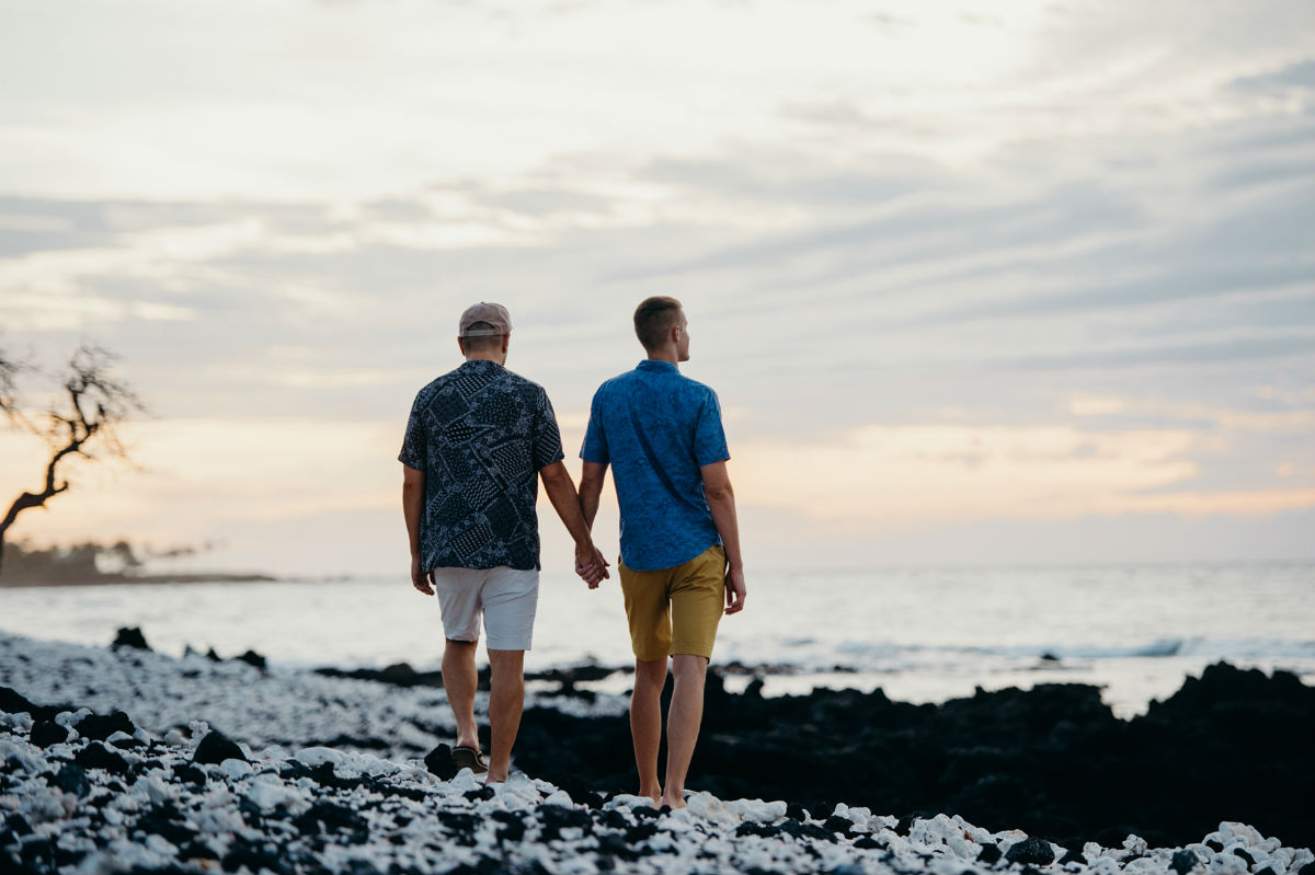 A couple explore Holoholokai Beach Park, Hawaii