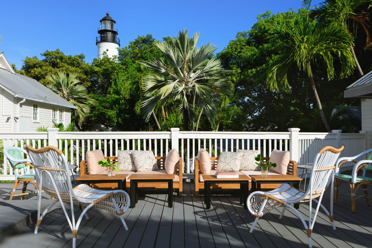 A terrace at the Kimpton Key West Lighthouse hotel