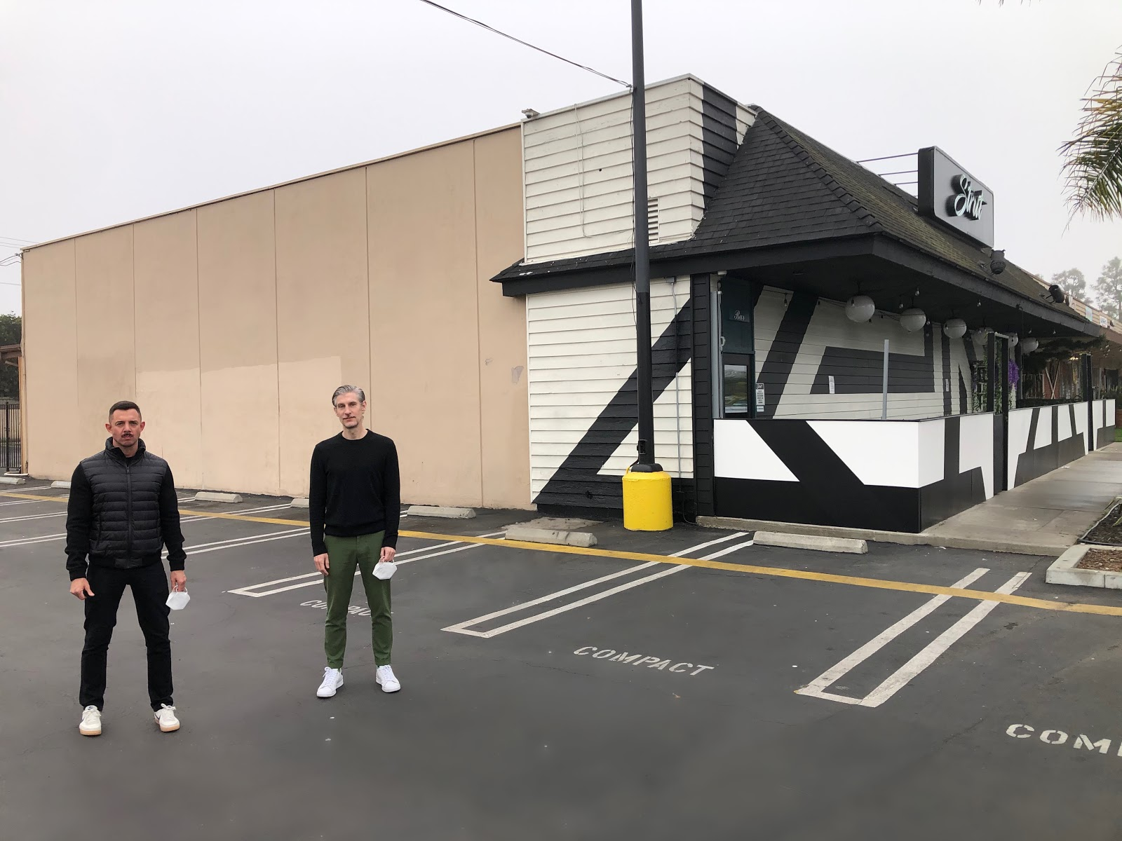 Strut CEO & Founder, Luke Nero (left) and local artist, David Gilmore in front of wall dedicated to mural at Strut, prior to the artwork being created