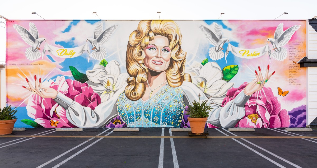 The finished Dolly Parton mural outside Strut