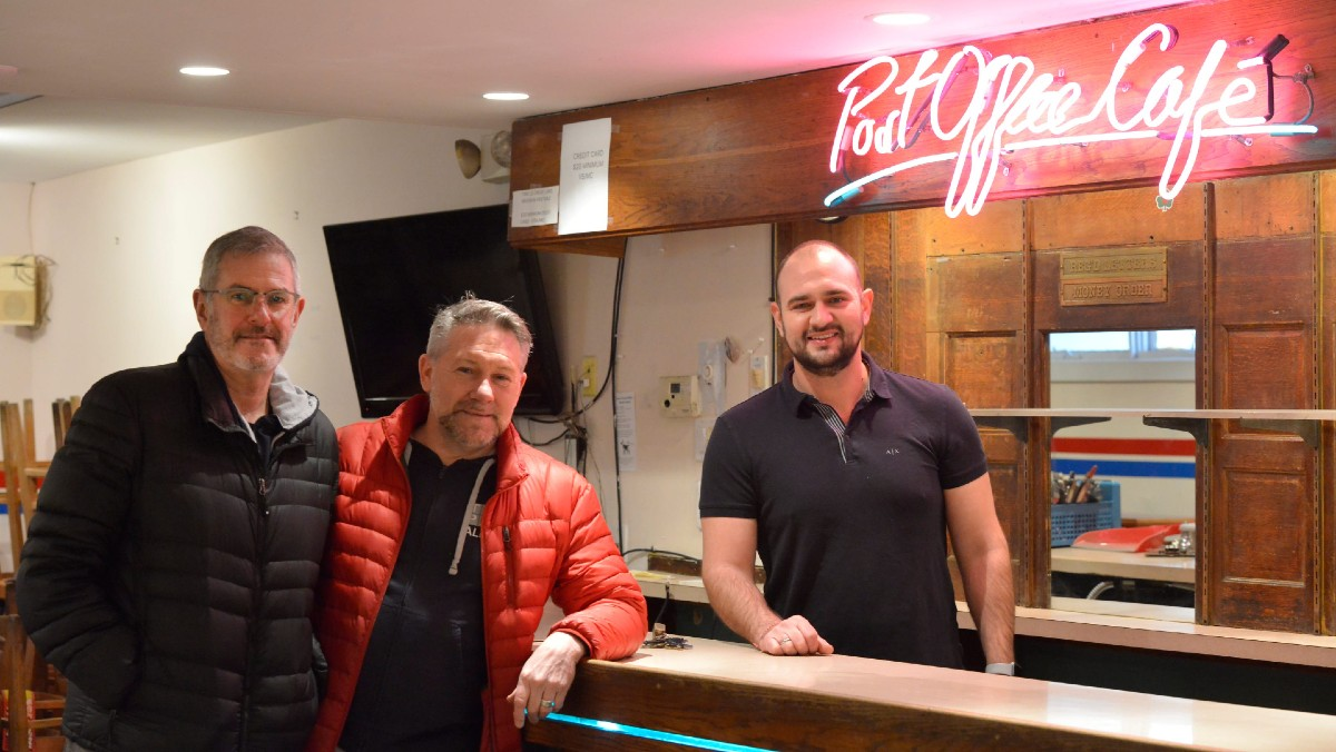 Husbands Paul Melanson and Jack Kelly (on the left) are the new owners of the Post Office Café in Provincetown