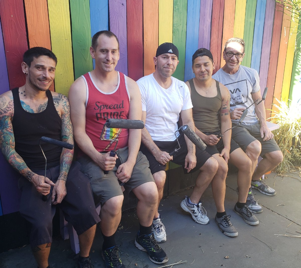 Repainting the rainbow fence at C Fenz last summer