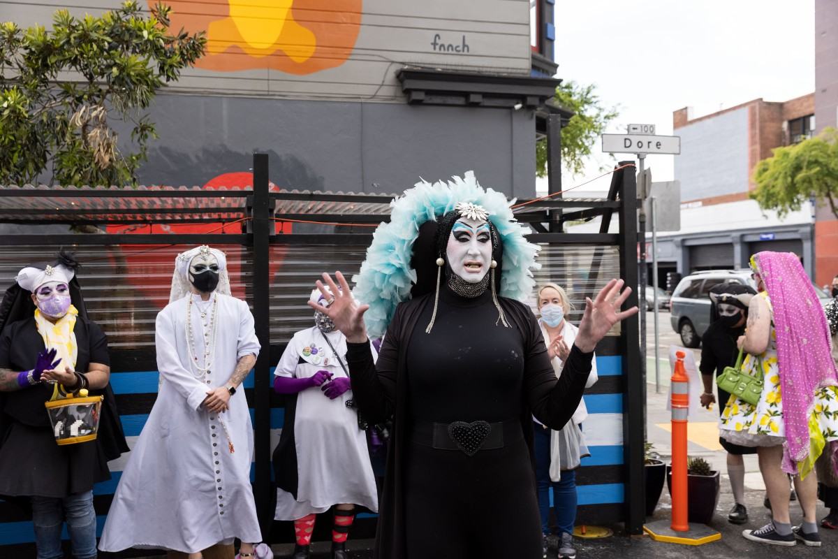 Sister Roma unveils the artwork outside Powerhouse in San Francisco