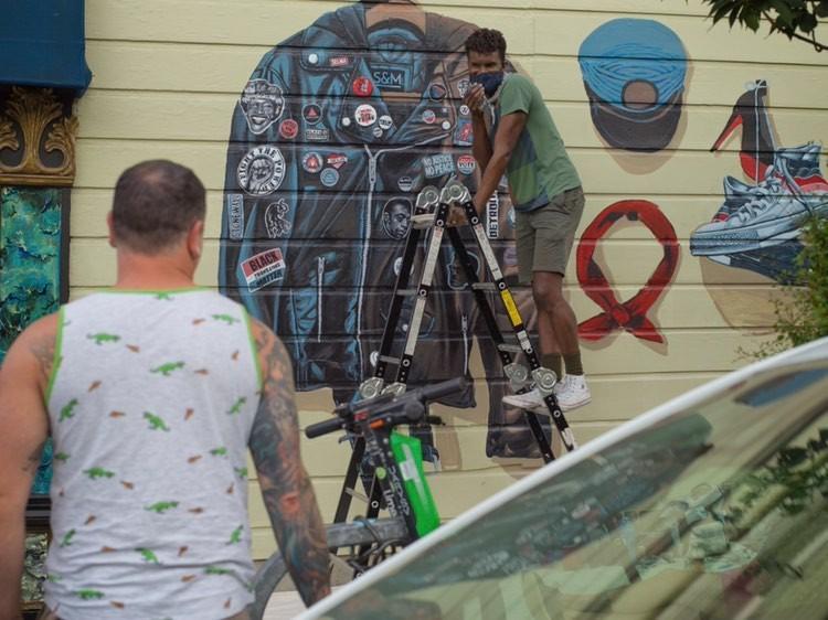 Serge Gay Jr painting his mural last year