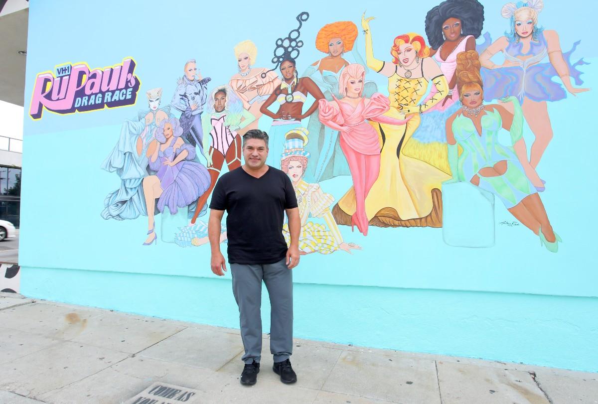 Artist Antonio Rael in front of his Drag Race mural