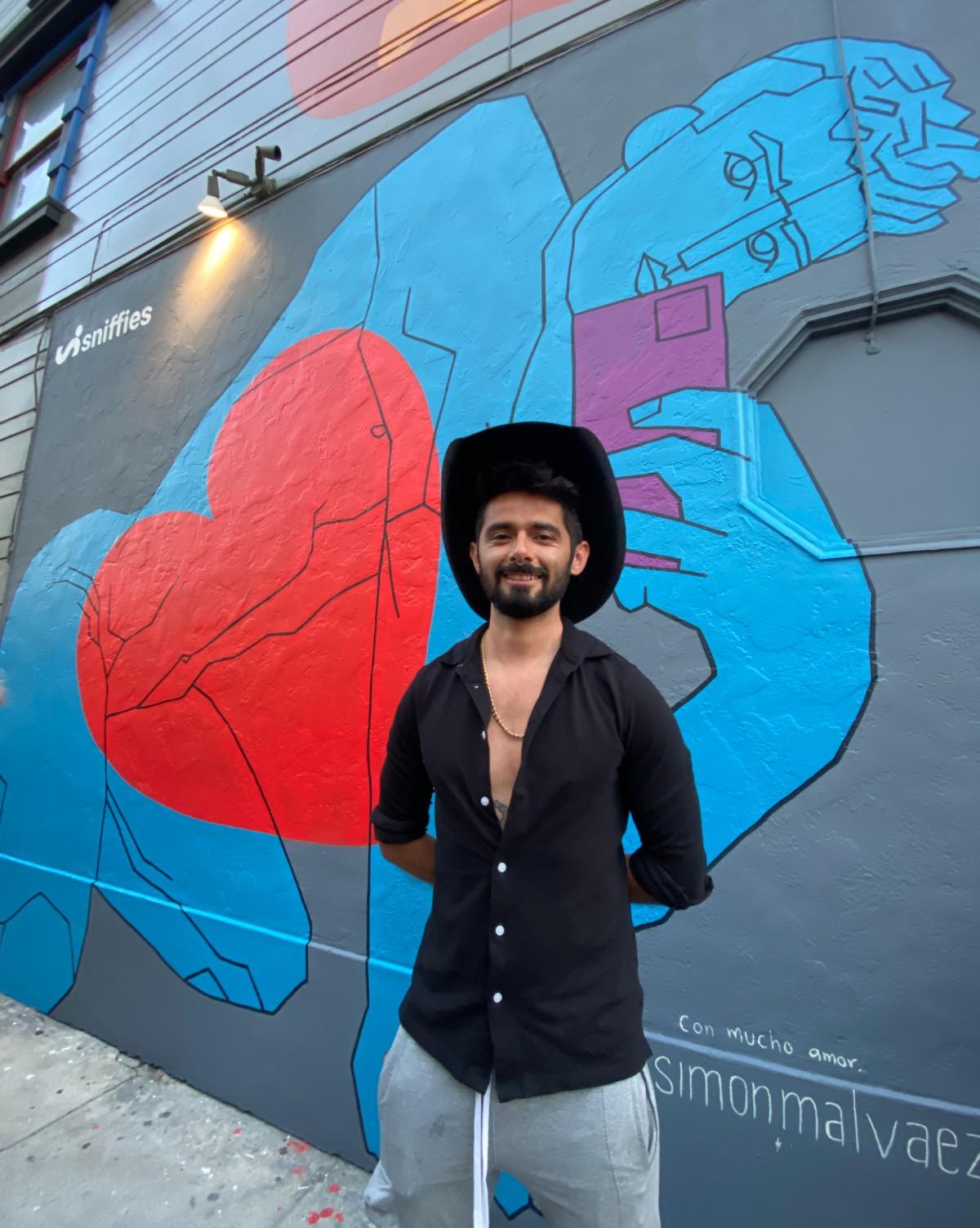 Simon Malvaez with his latest work in San Francisco