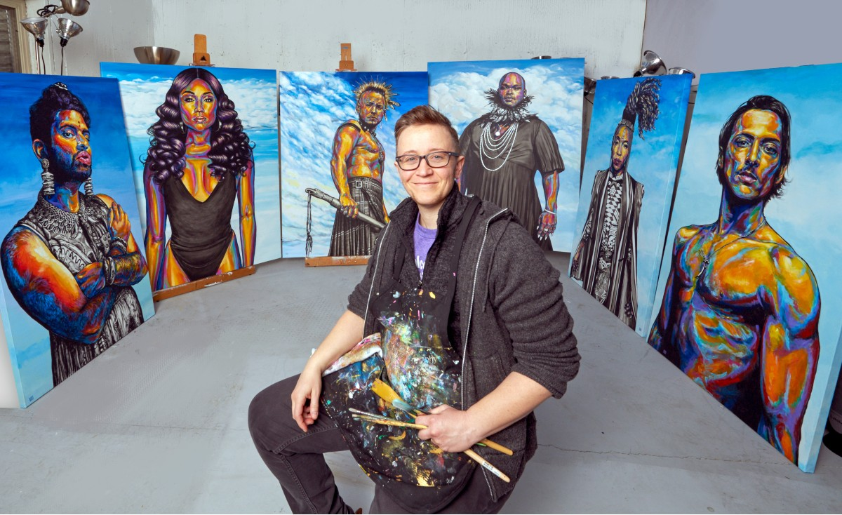 Rae Senarighi with some of his trans portraits