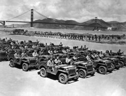 U.S. Army soldiers sitting in a formation of jeeps. The Golden Gate Bridge is in the background. Exact Date Shot Unknown