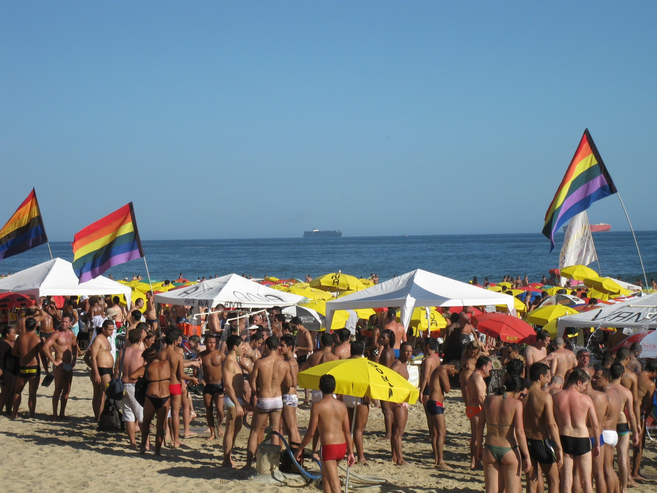 Gay flags on Rio beach in GayCities and ManAboutWorld gay travel magazine